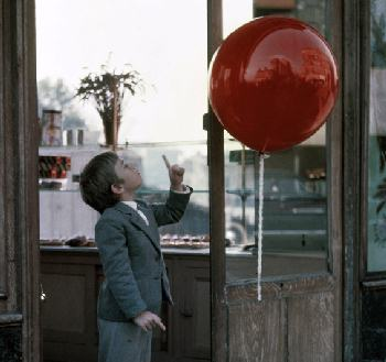 boy and red balloon